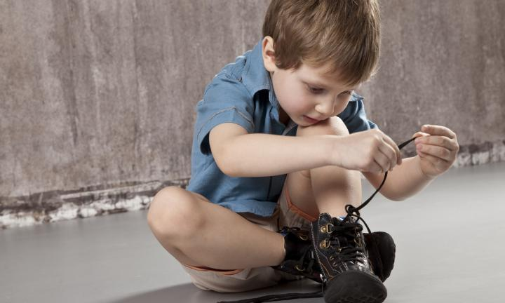 Child Tying Shoe